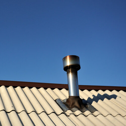 Corrugated metal roof and chimney.