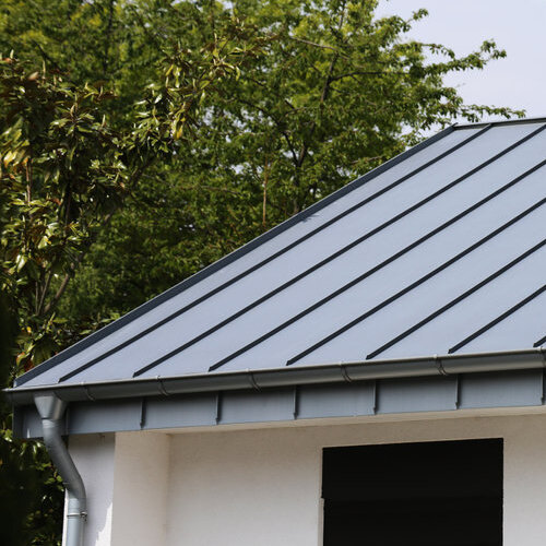 Home with a gray standing seam metal roof.